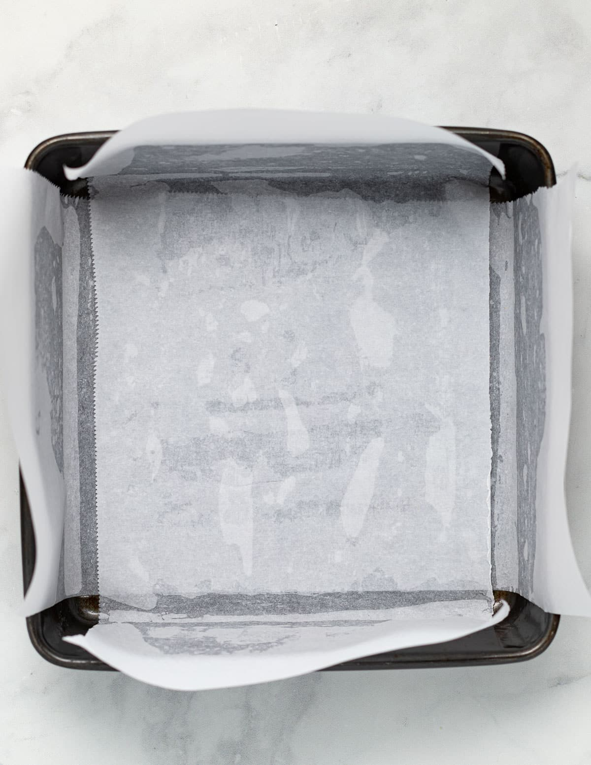 a lined 8 x 8 inch baking pan