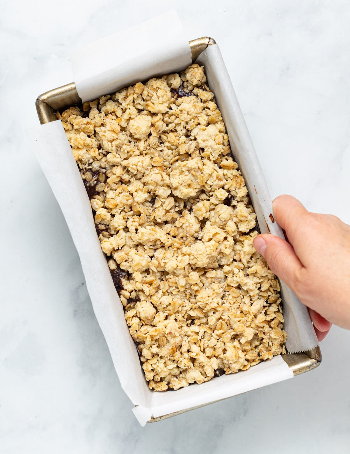 chocolate oat bars in a pan before cutting up