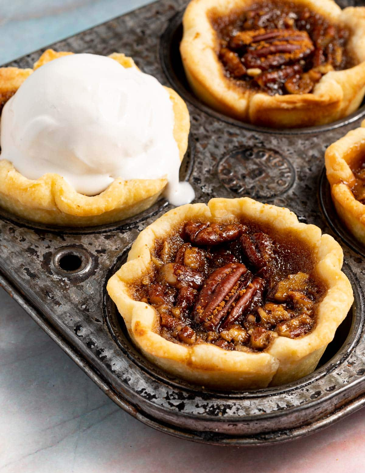 butter tarts in a pan, one topped with ice cream