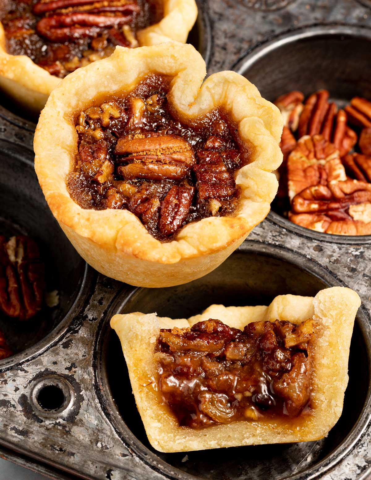 a butter tart and half a butter tart showing the filling