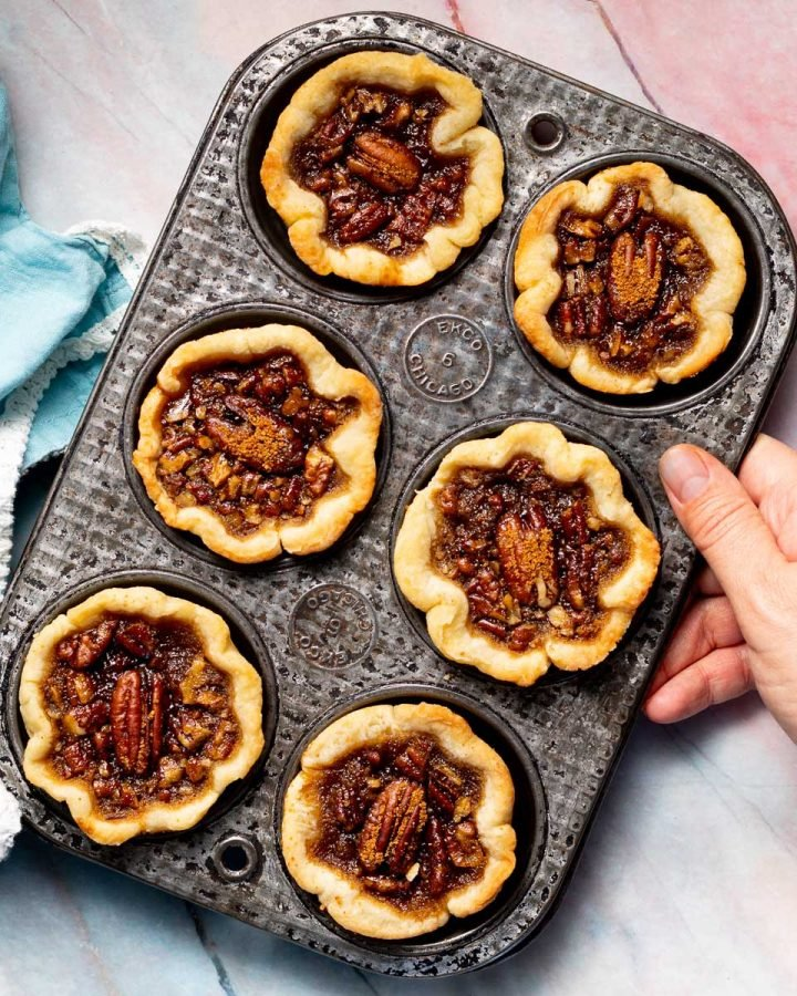 a muffin pan full of vegan butter tarts