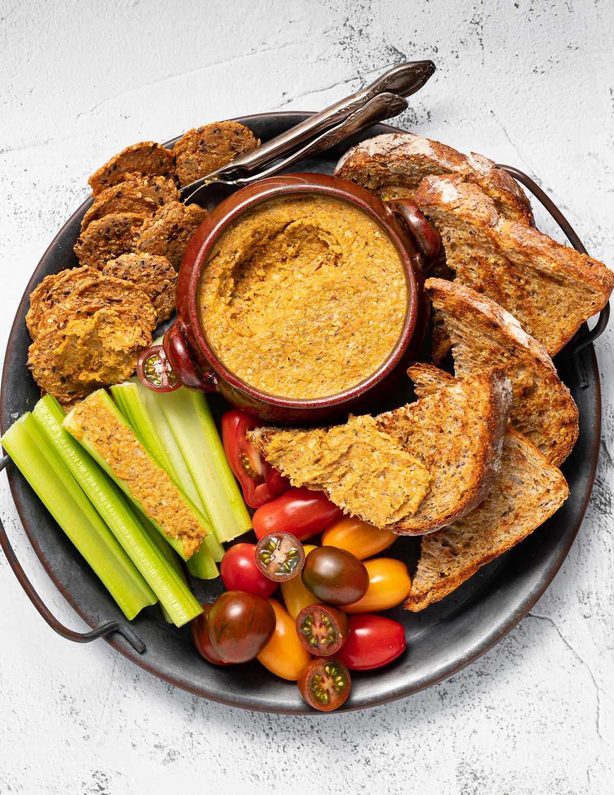 a tray of vegetable pate and accompiments