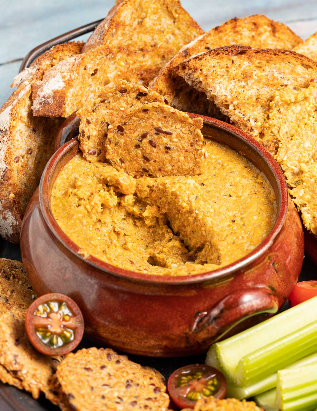 a bowl of vegetable pate with crackers