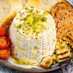 a molded vegan ricotta with olive oil drizzles