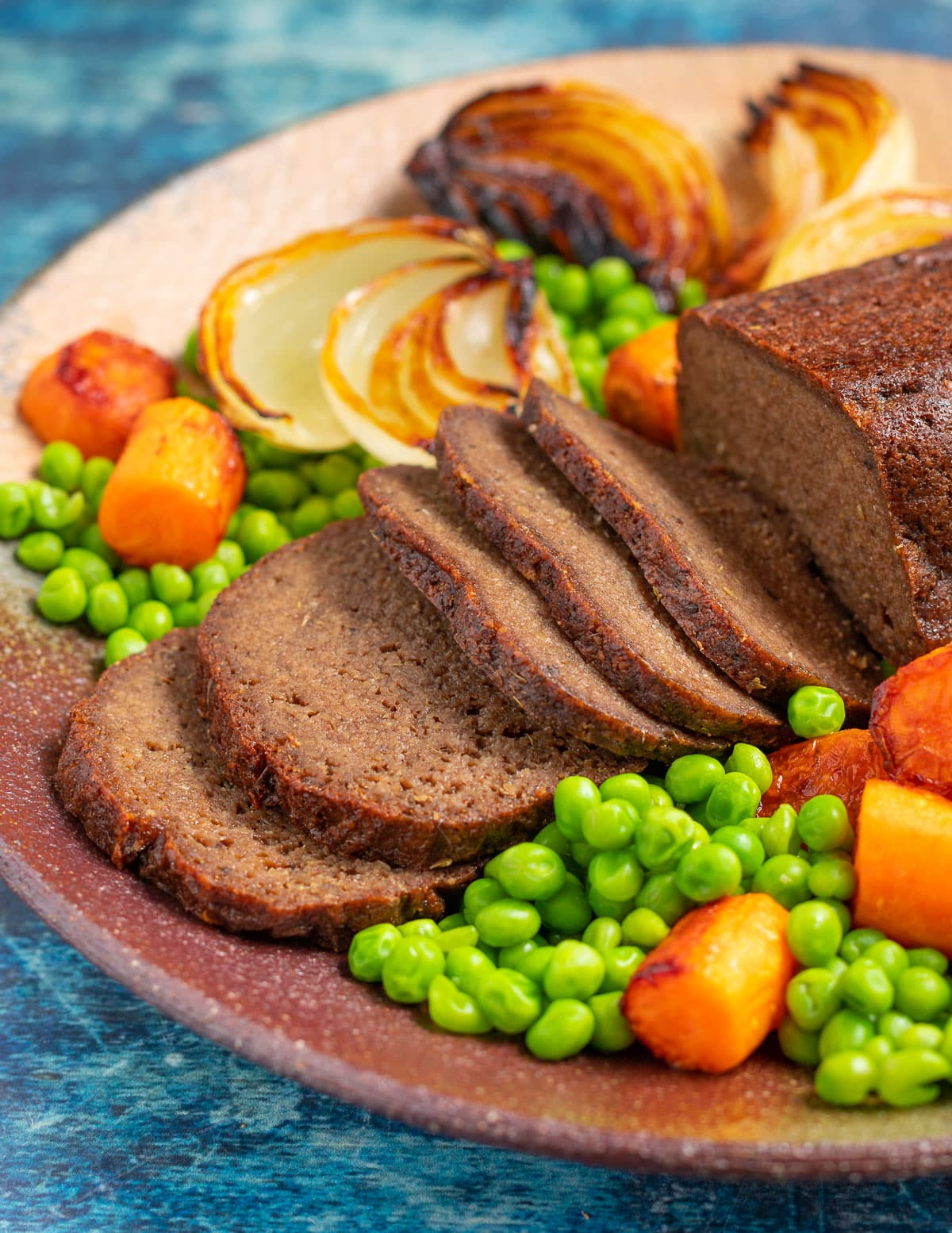 a sliced vegan and gluten-free roast with vegetables