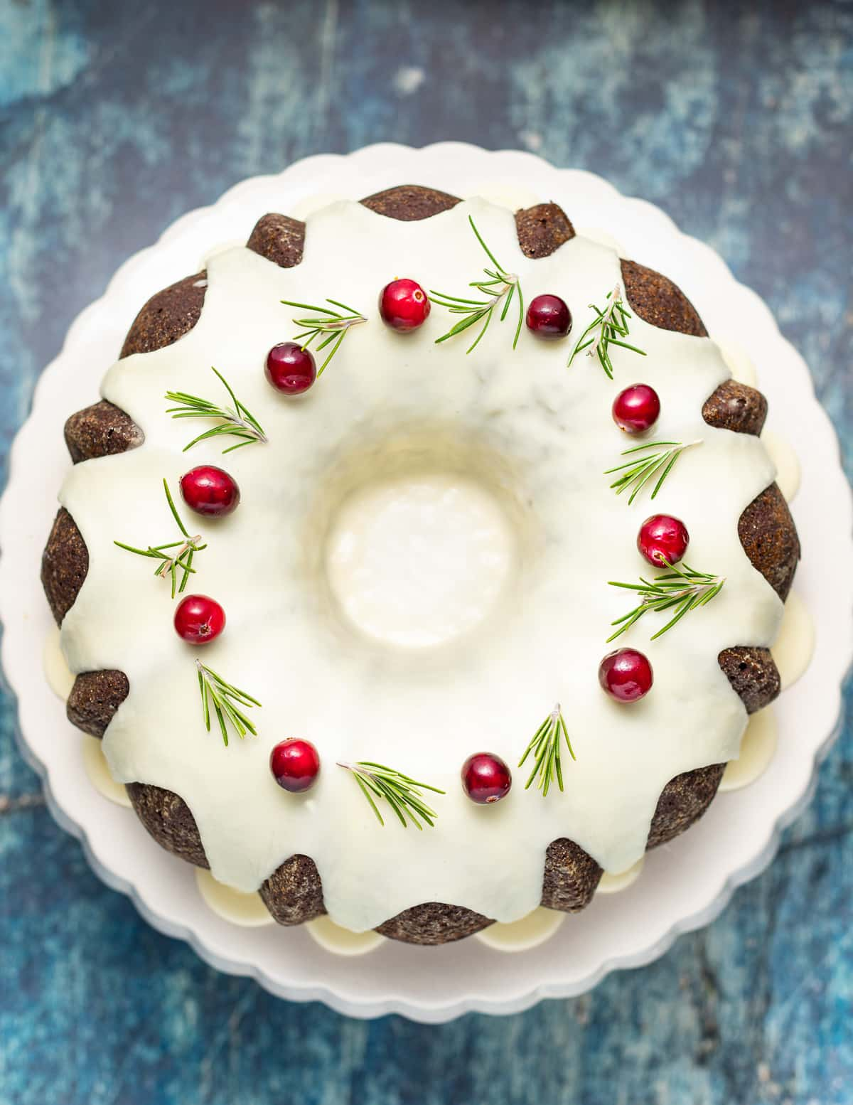 a vegan gingerbread cake with glaze and fresh cranberries