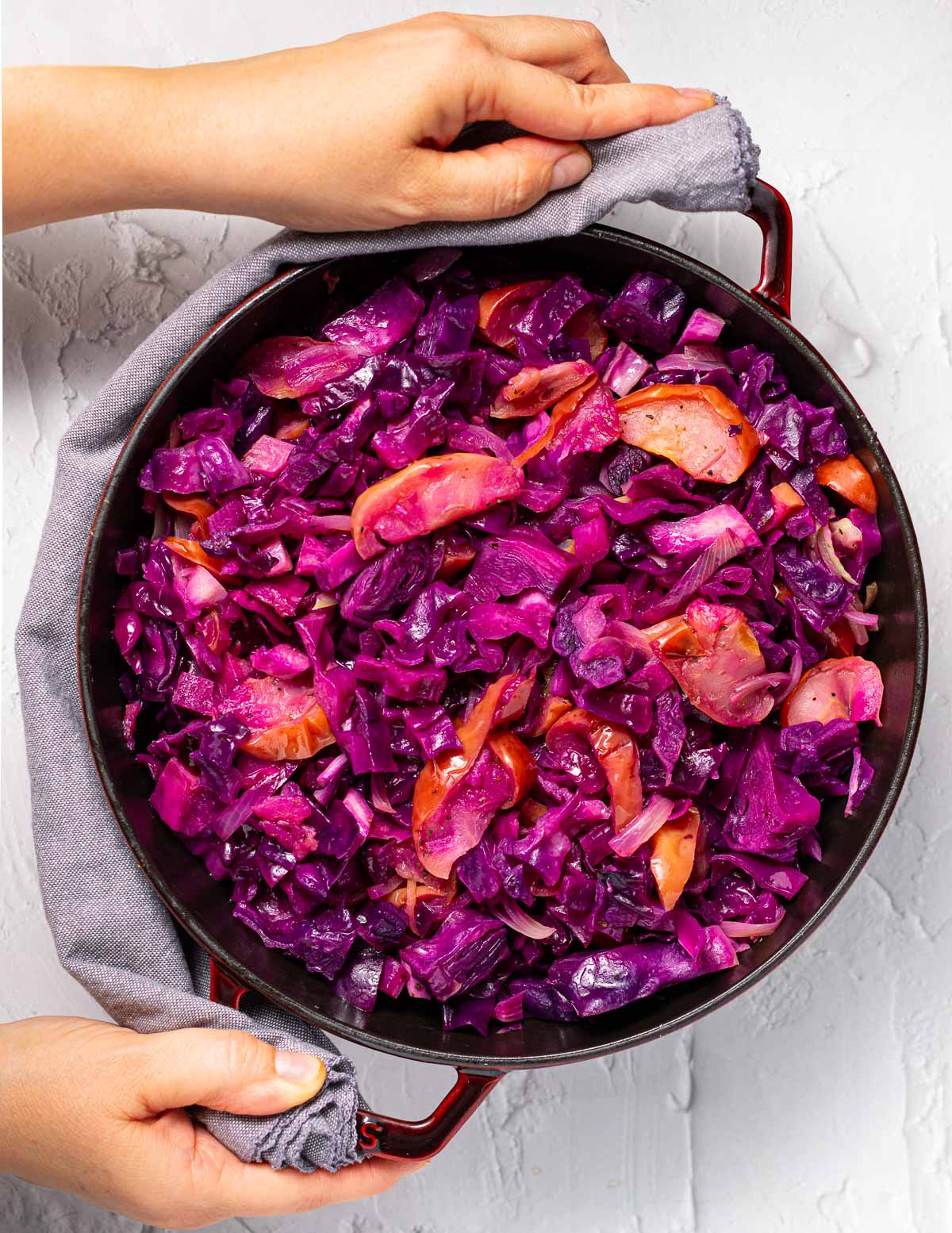 baked red cabbage and apples in a staub skillet