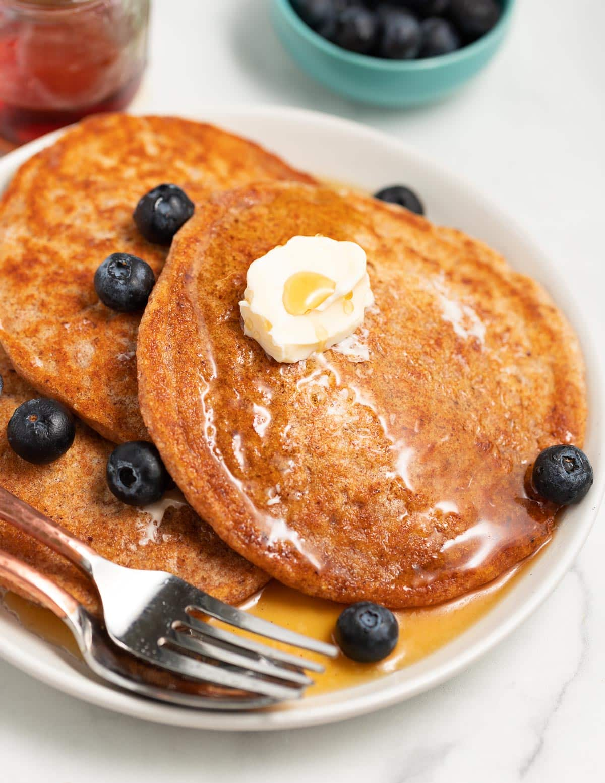 gingerbread pancakes on a plate with blueberries
