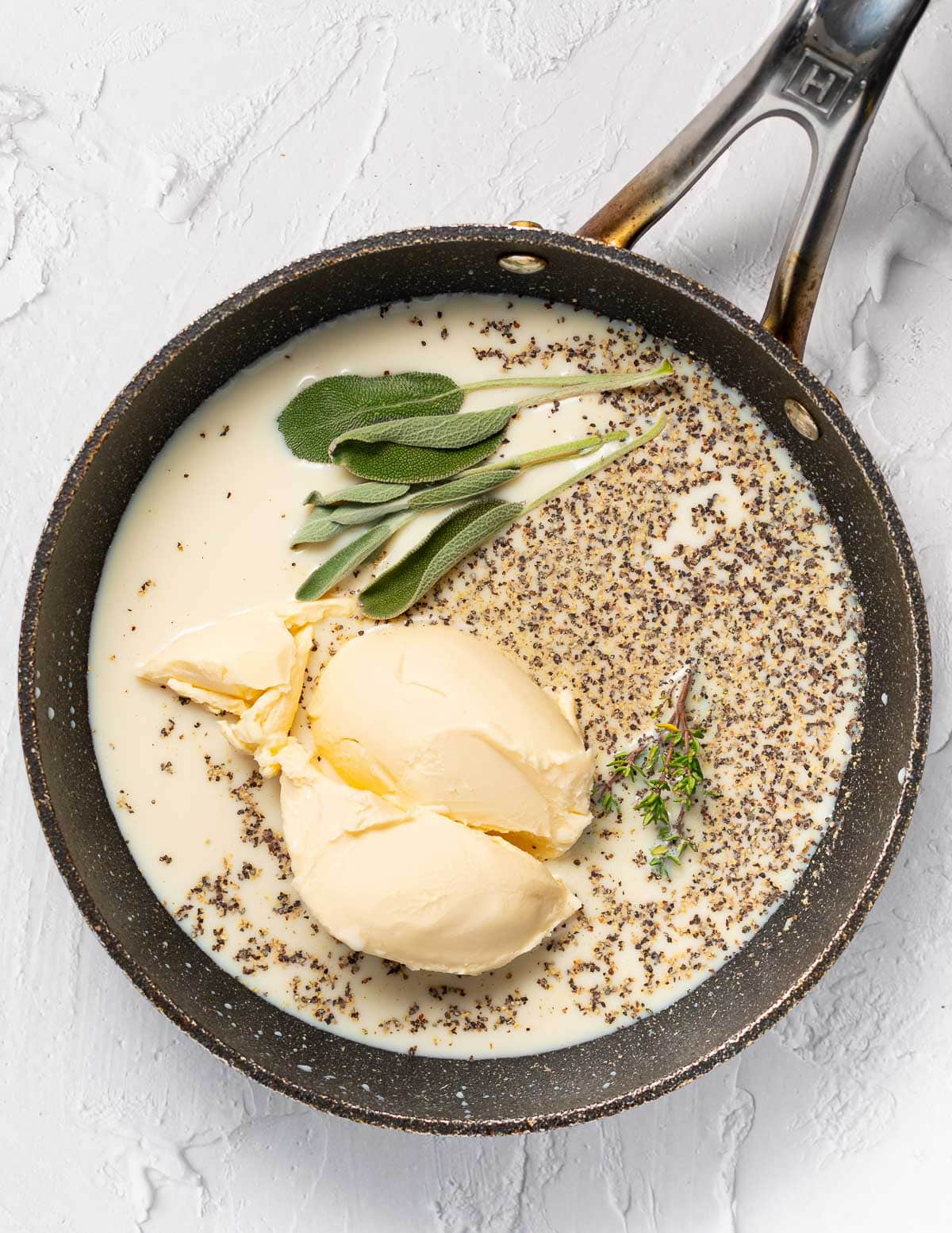 soy milk, vegan butter, pepper and herbs in a pan