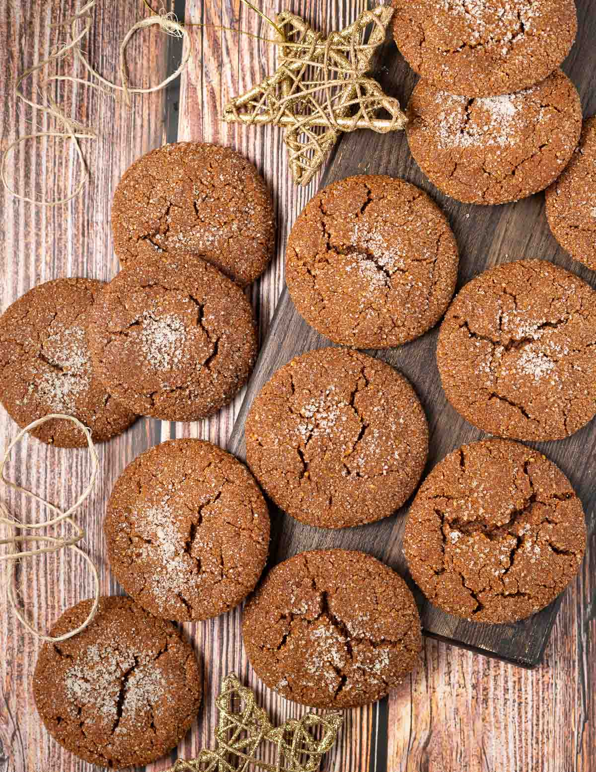 molasses cookies on a wooden board with star ornaments
