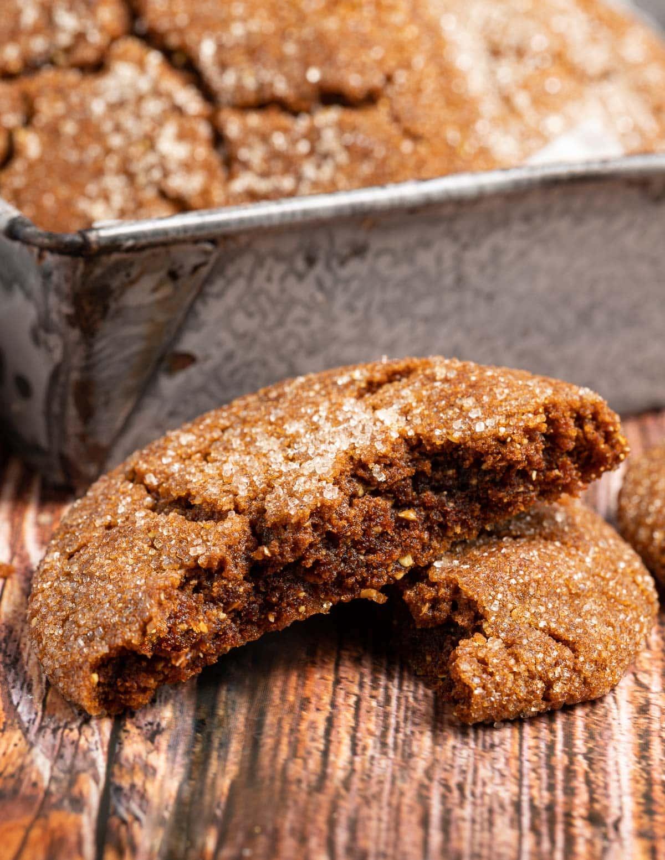 a vegan molasses cookie broken in half to show the inside