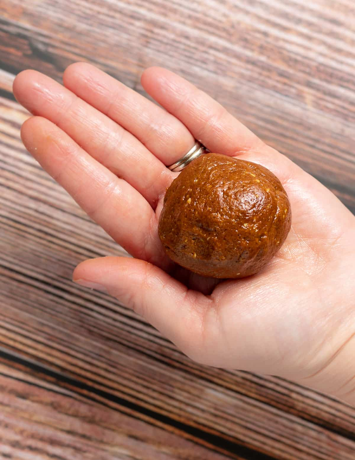 a cookie dough ball on a hand