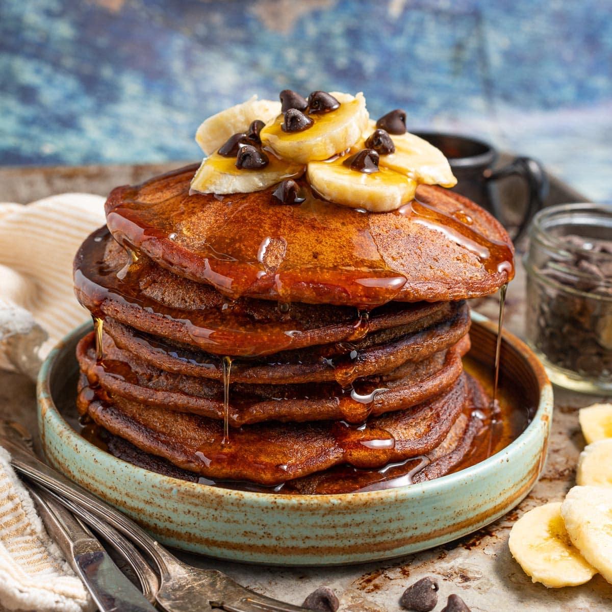 a stack of chocolate banana pancakes