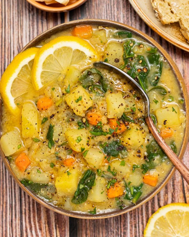 a bowl of Instant Pot Red Lentil Soup with lemon slice garnish
