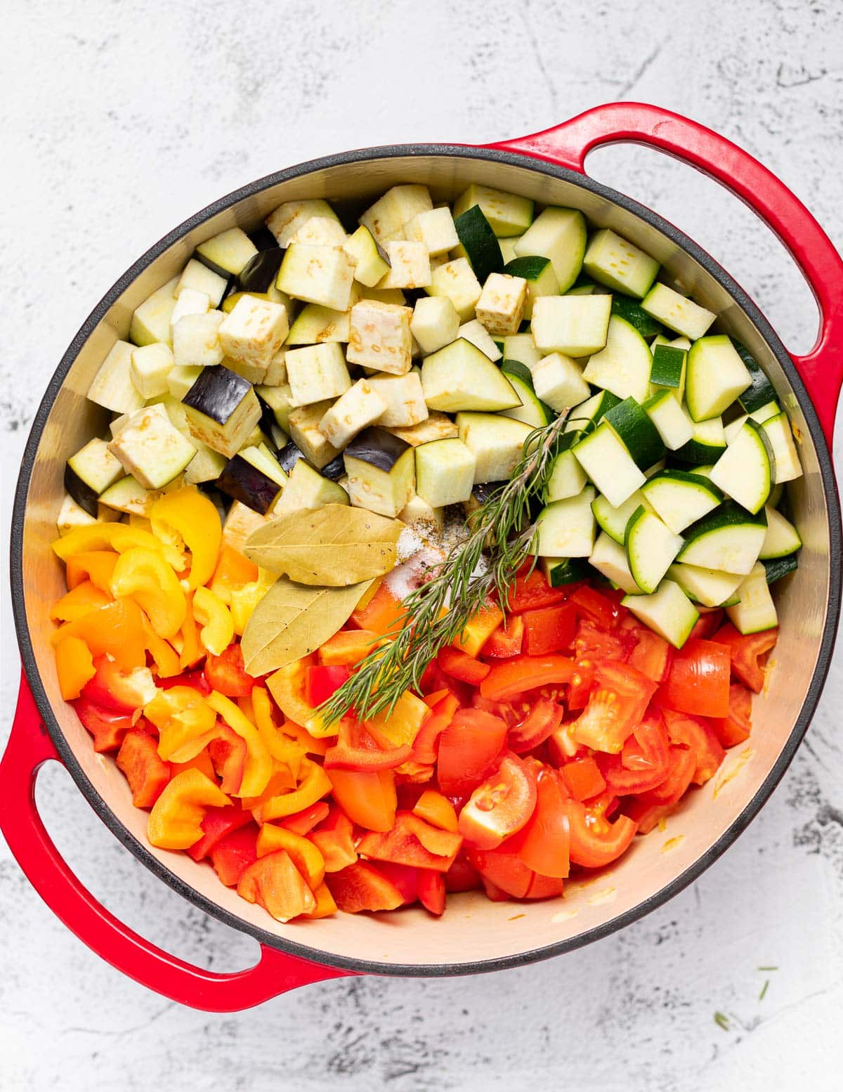 various diced vegetables in a dutch oven