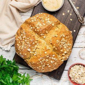 a loaf of vegan soda bread on a wooden board
