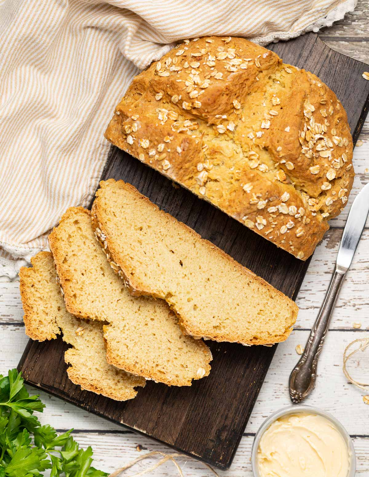 a partially sliced loaf of soda bread