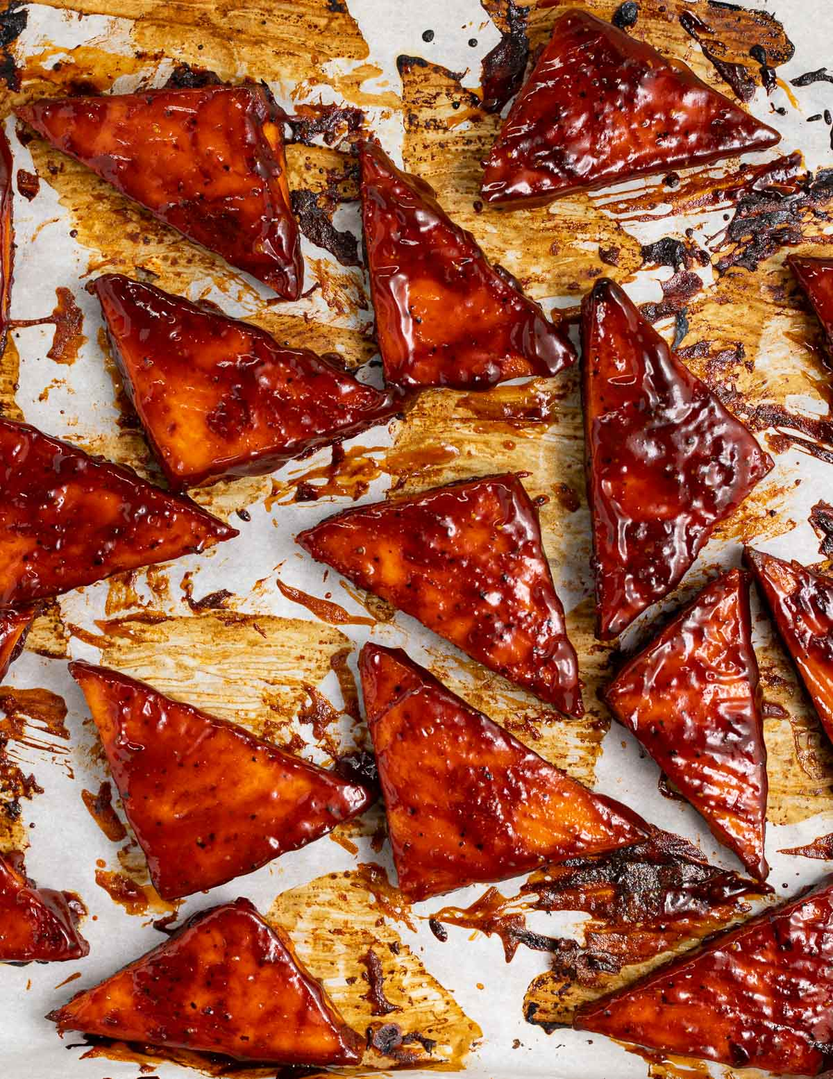 triangles of sticky tofu on a tray