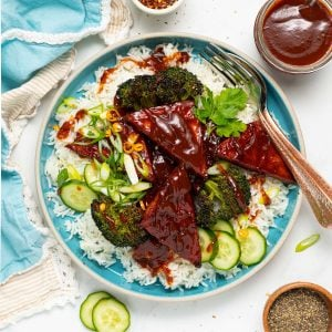 a blue plate with rice, broccoli and BBQ tofu