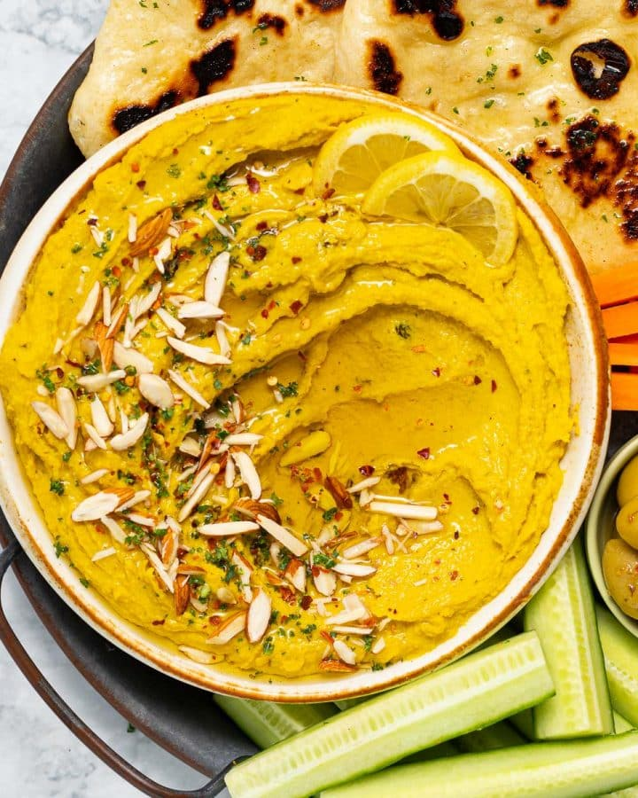 a bowl of curry hummus