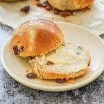 a sliced hot cross bun