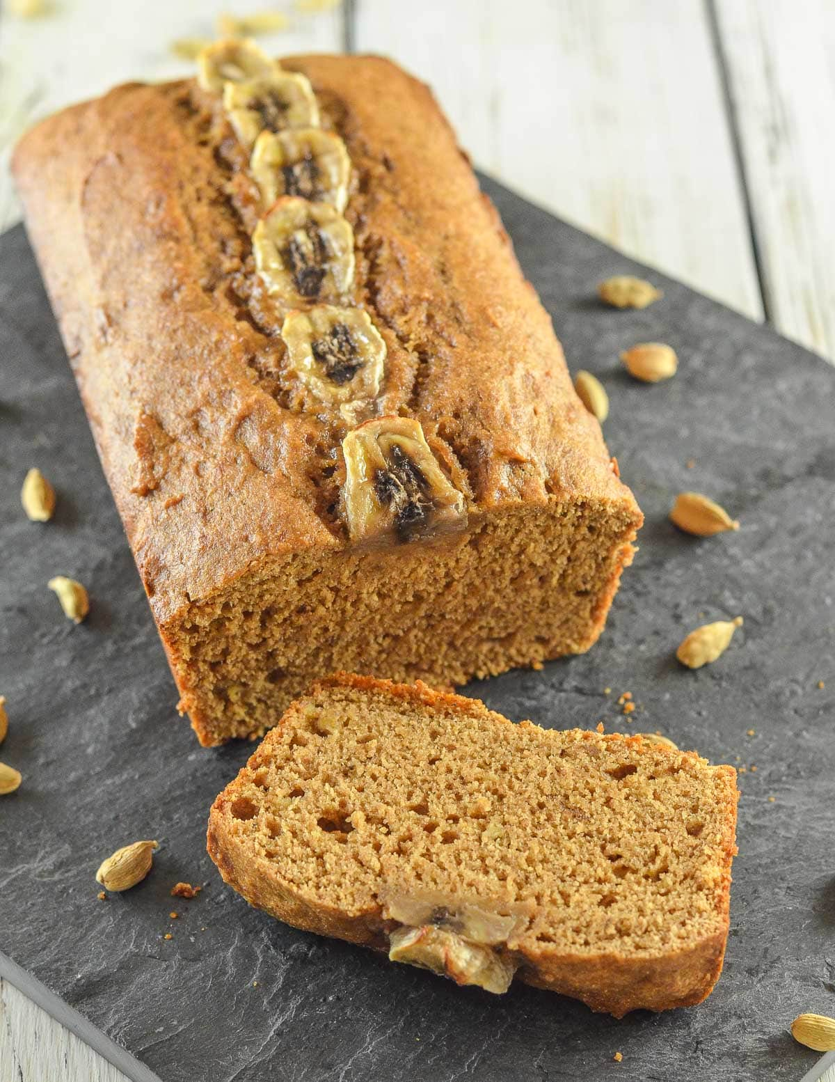 a loaf of banana bread with a slice cut
