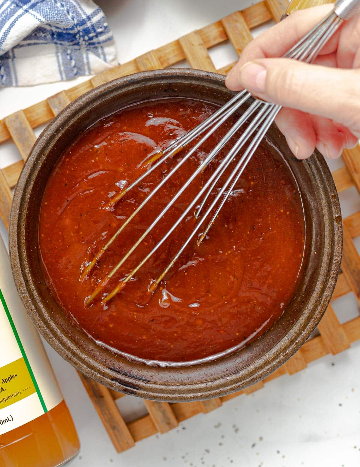 whisking BBQ sauce in a pan