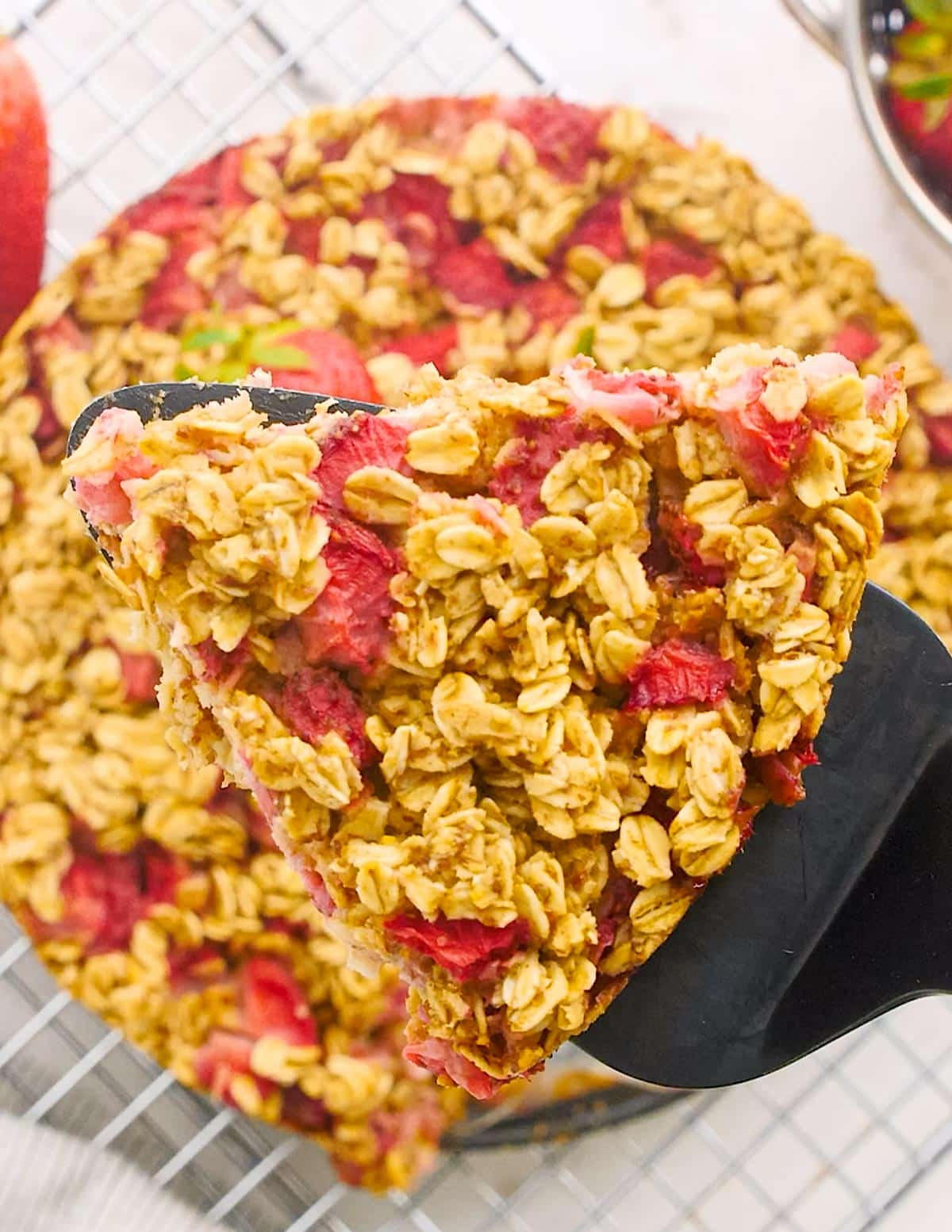 a slice of strawberry baked oatmeal
