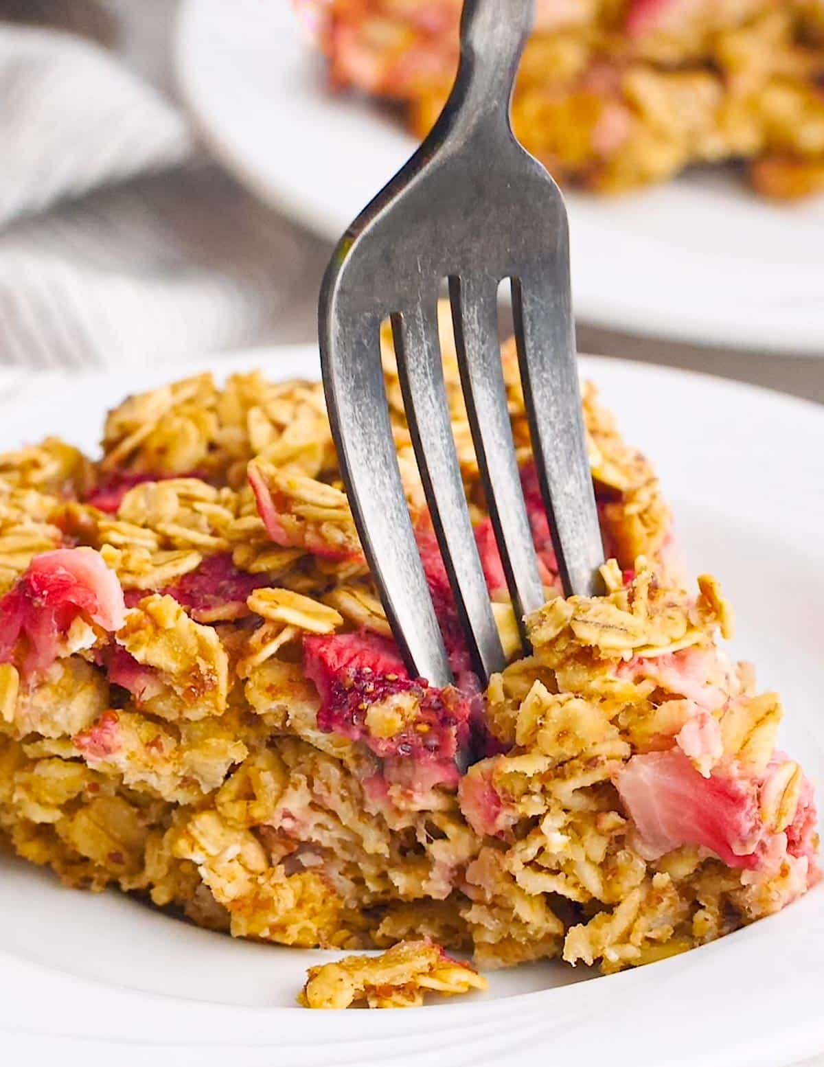 a fork going into a slice of baked oatmeal