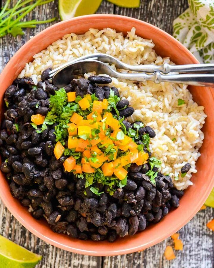 a bowl of sloe cooker black beans over rice