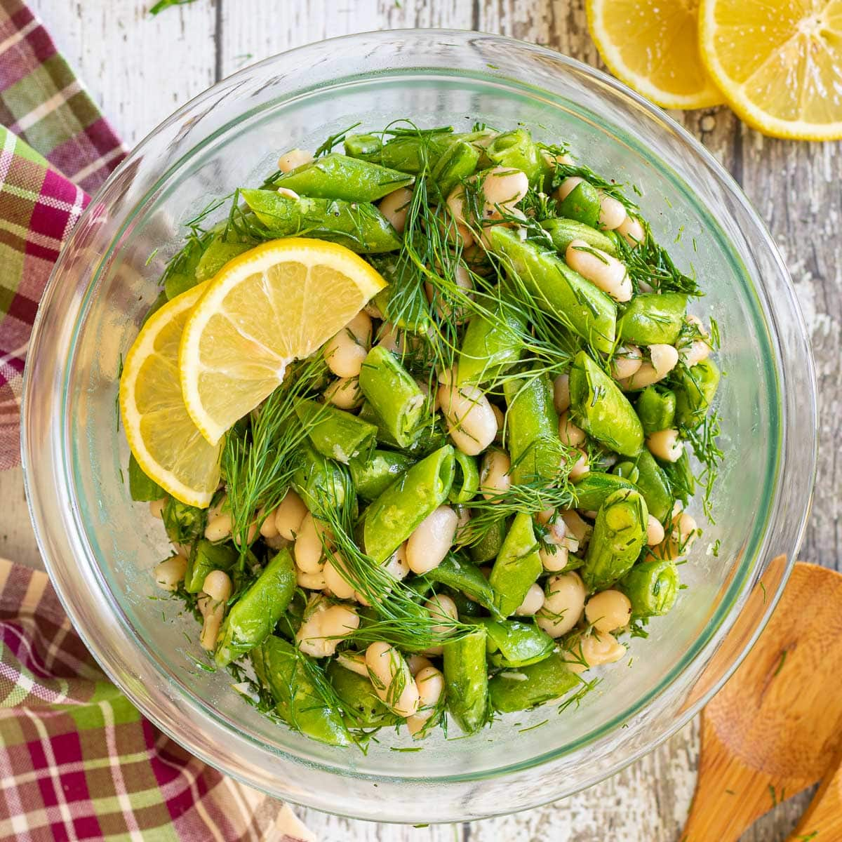 sugar snap pea salad with lemon slice garnish