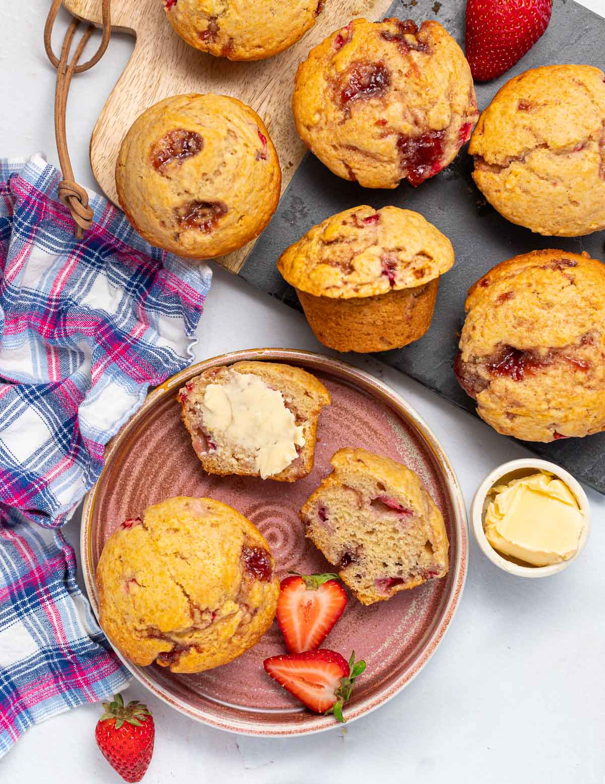 strawberry muffins on a board and plate