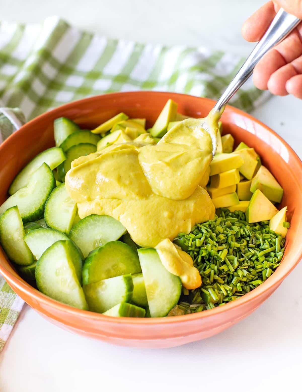 avocado dressing on a cucumber salad