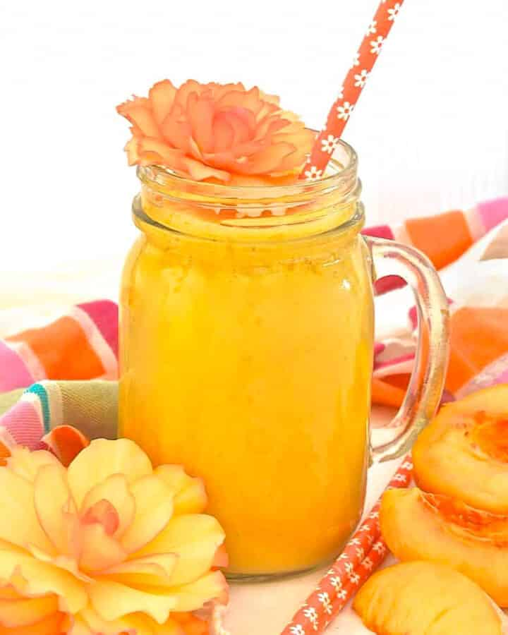 peach smoothie with orange flowers for decoration