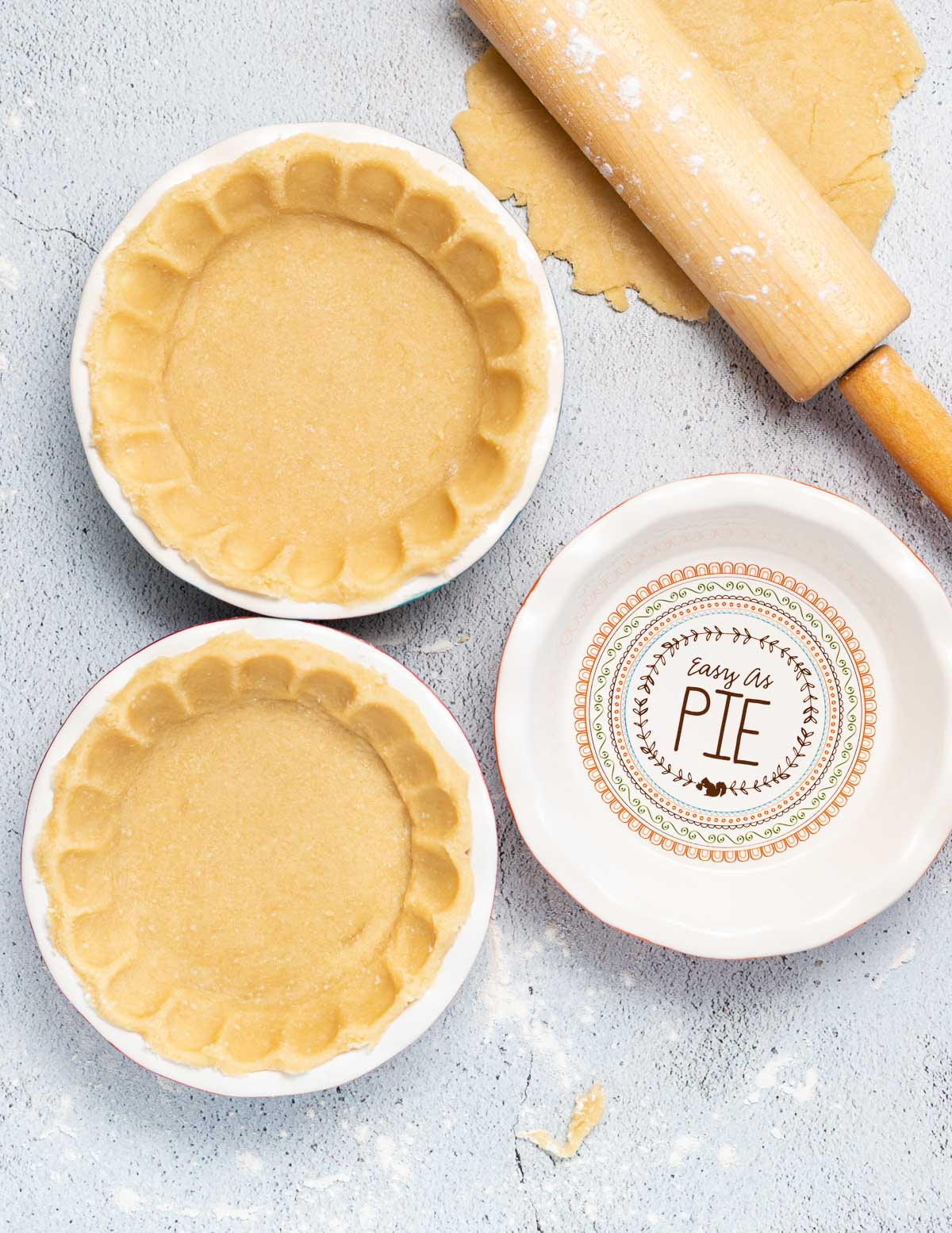 2 pie crusts and an empty pie dish