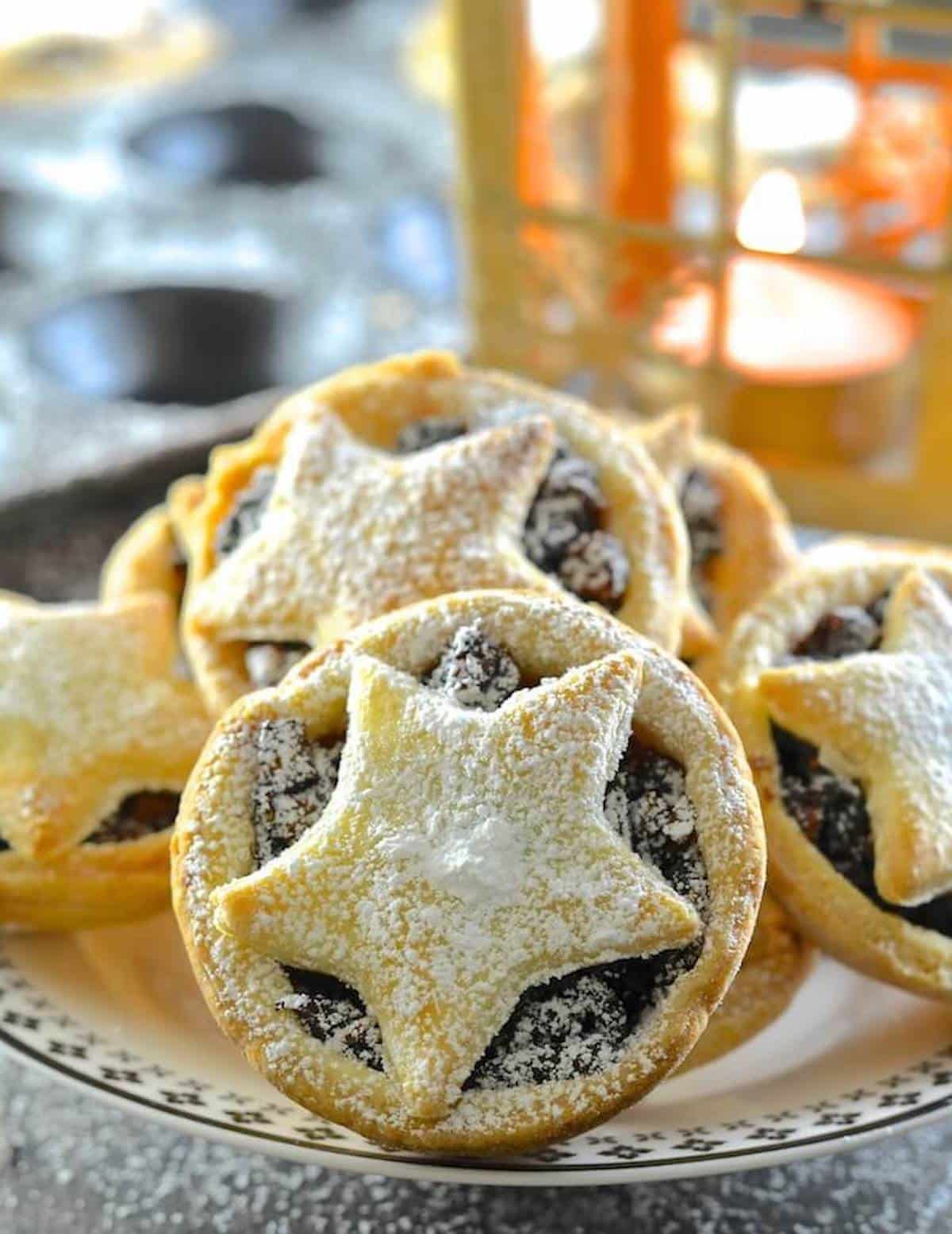 vegan mince pies with a candle in the background