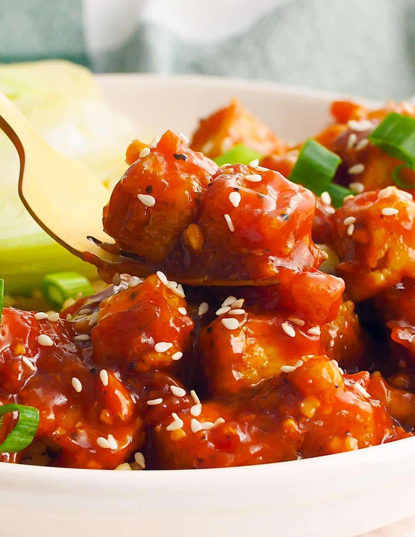 sticky tofu on a fork