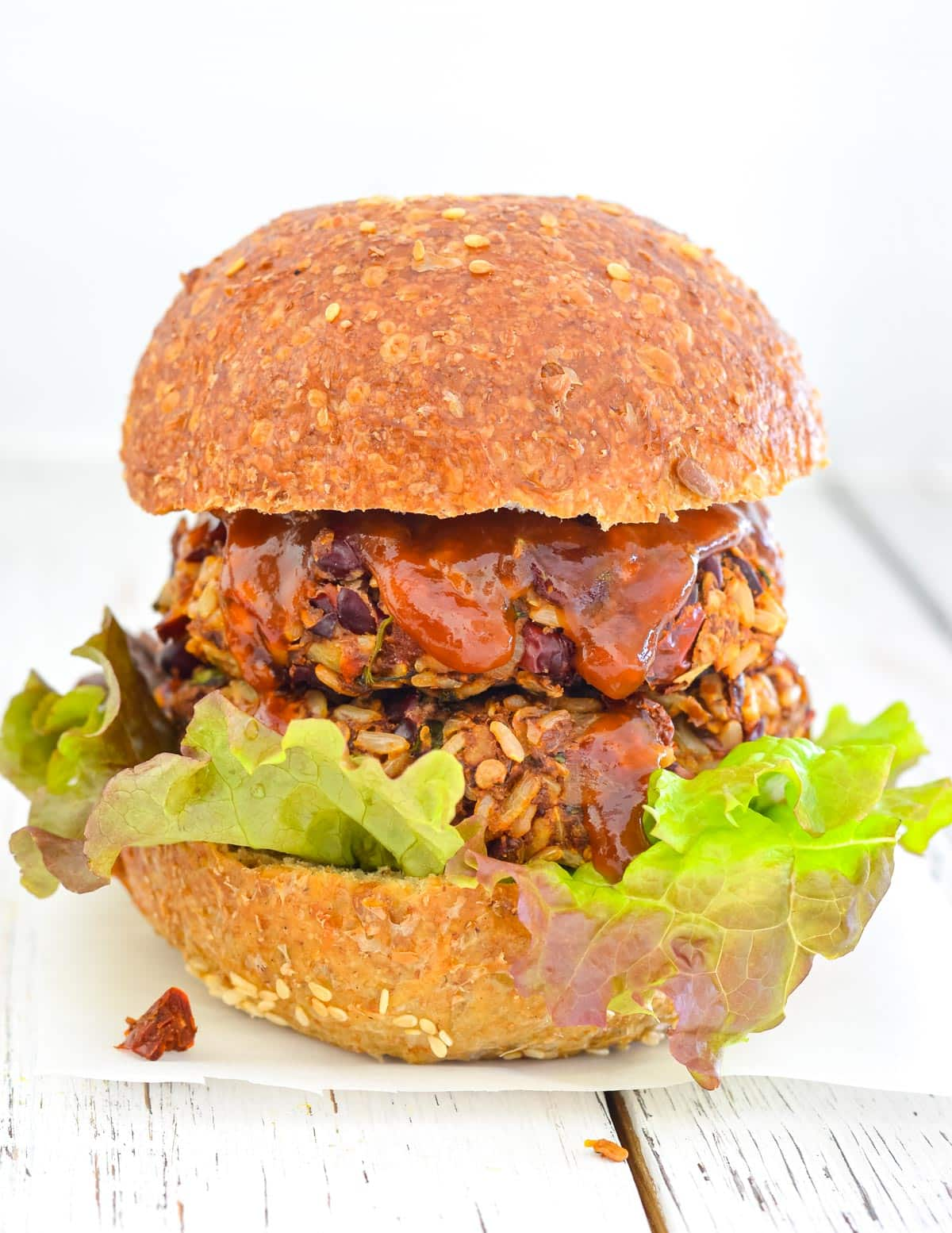 rice and red bean burgers in a bun with lettuce and sauce