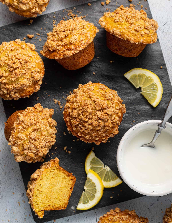 streusel topped muffins, lemon slices & a bowl of glaze