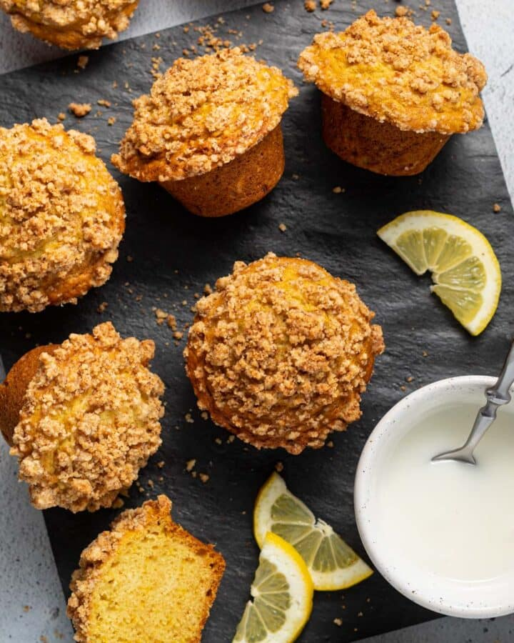 muffins with streusel topping on a slate board