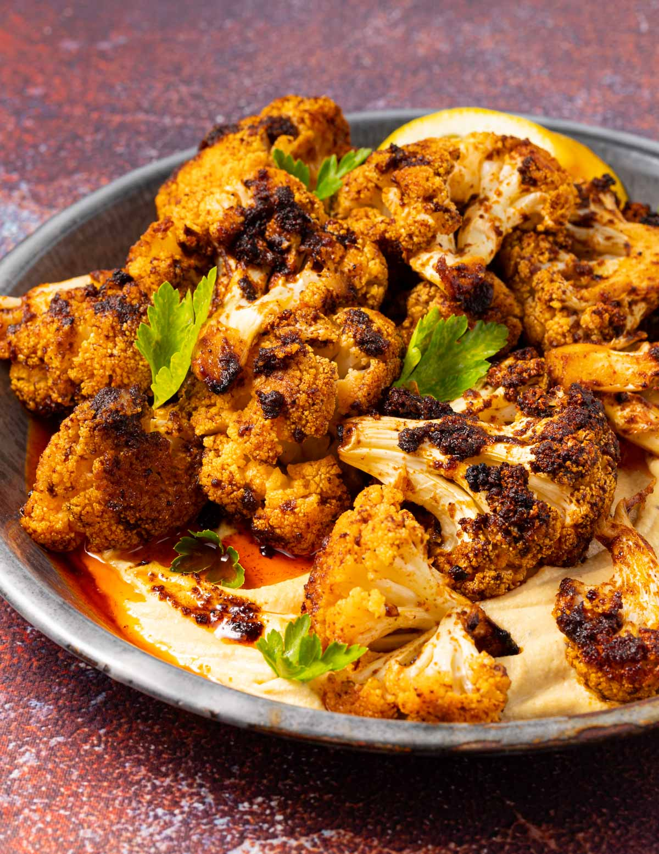 spicy roasted cauliflower on hummus