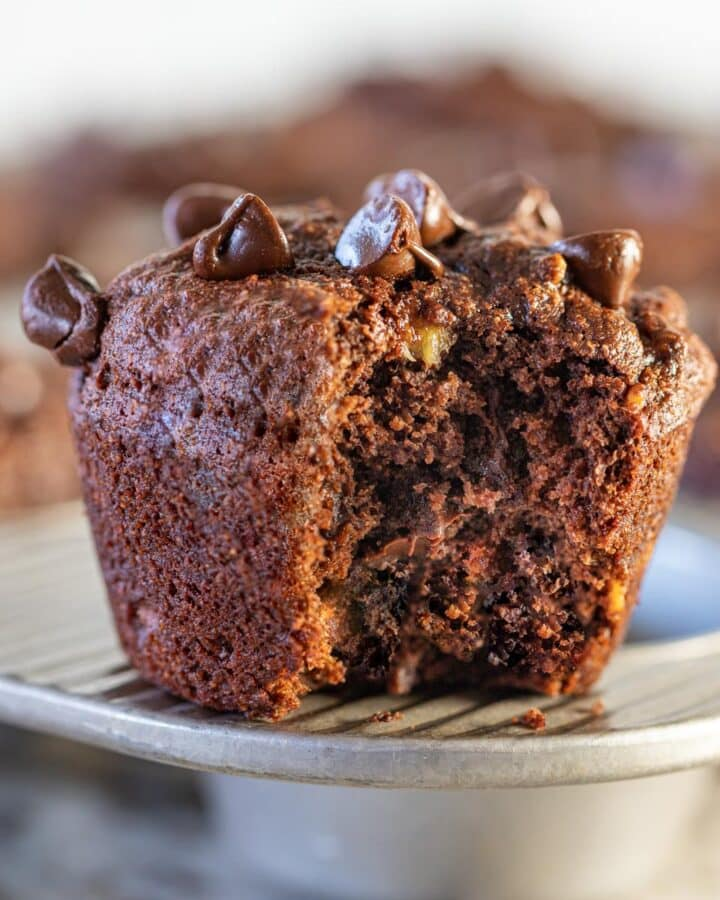 a vegan chocolate banana muffin with a bite taken out