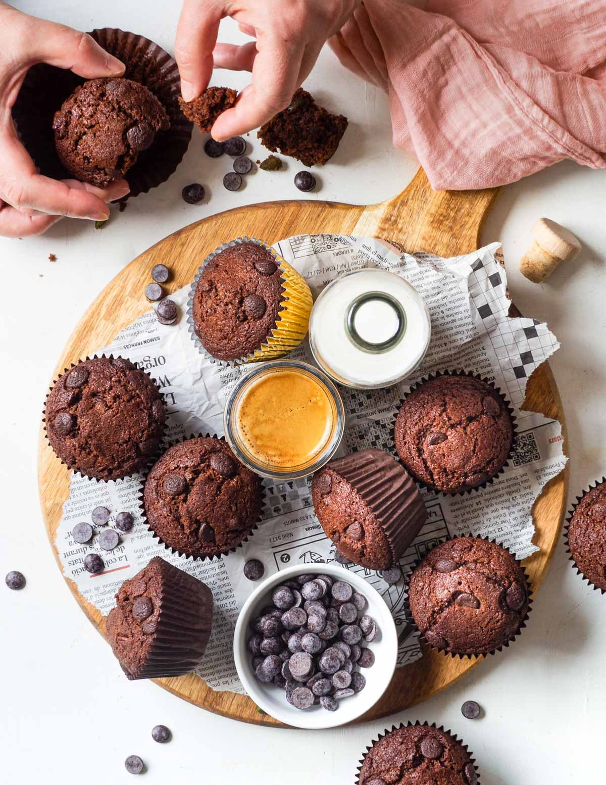 muffins on a wooden board with hands breaking one open
