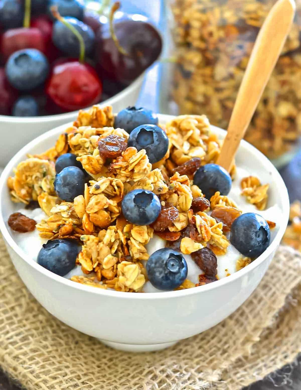 a bowl of vegan granola with yogurt and berries