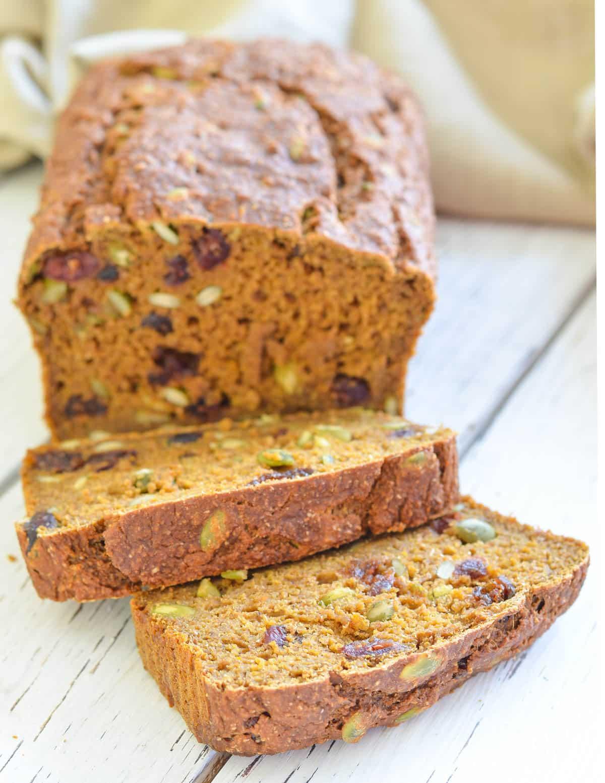 a sliced loaf of vegan pumpkin bread