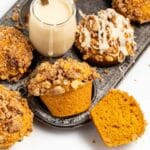streusel topped pumpkin muffins and a small pot of maple glaze