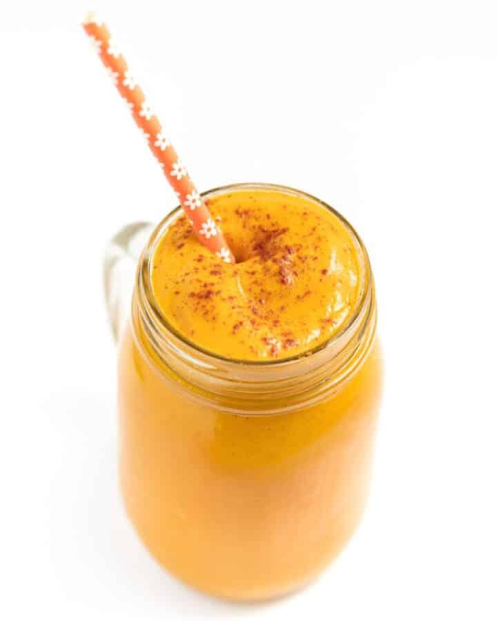 a glass of vegan pumpkin smoothie