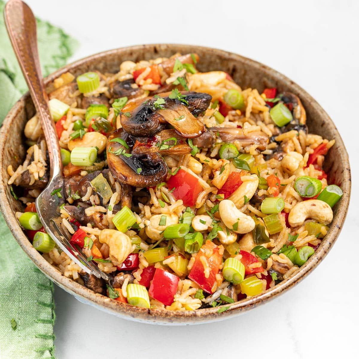 a bowl of mushroom fried rice